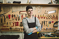 Young mechanic working in repair garage - RAEF000789