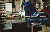 Young mechanic working in repair garage - RAEF000801