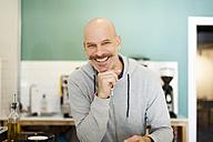 Mature man standing in restaurant, smiling - VABF000081
