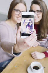 Two young women taking a selfie with smartphone - ALBF000024