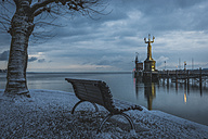 Germany, Constance, Lake Constance, bench facing the harbour entrance with Imperia statue in the morning - KEBF000334