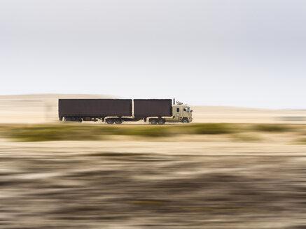 Namibia, Erongo, truck drivin fast on coastal road C34 - AMF004702