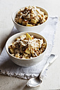 Two bowls of vegan quinoa porridge with apple and pecan - EVGF002784