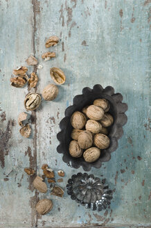 Two cake pans and walnuts on wood - ASF005820