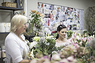 Two women in flower shop - ZEF008119