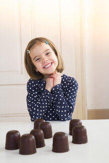 Portrait of happy girl with chocolate marshmallows - LVF004484