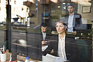 Group of people working at office near to window - JASF000356