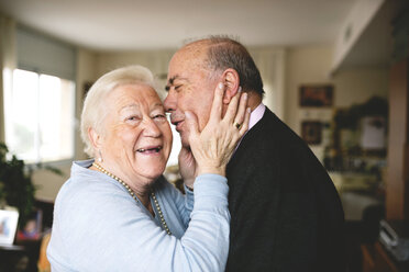Affectionate senior couple at home - GEMF000671