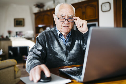 Portrait of senior man with laptop at home - JRFF000360