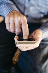Hands of senior man using  smartphone - JRFF000381