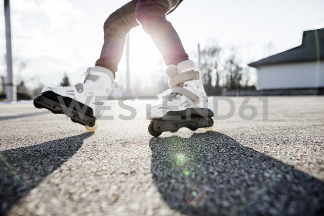 Close-up of young man inline skating - DAWF000495