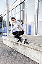 Young man doing a trick on inline skates - DAWF000504