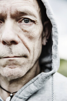 Portrait of pale man wearing hooded jacket, close-up - JATF000826