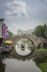China, Shanghai, Bridge with tourists in Qibao Ancient Town - NKF000448