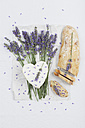 French cow's milk cheese, heart-shaped, lavender blossom, baguette on serviette - GWF004587