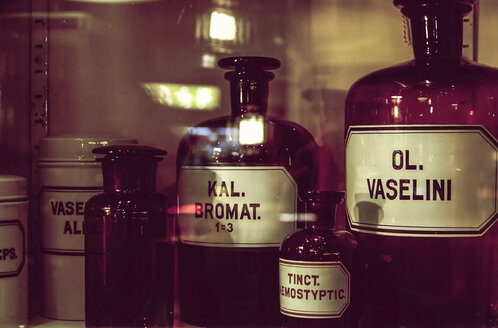 Old apothecary bottles in an apothecary cabinet - HOHF001388