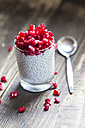 Glass of chia pudding with pomegranate seeds - SARF002515