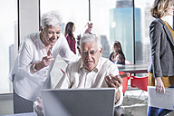 Senior colleagues in office and meeting in background - ZEF008316