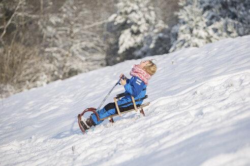 Girl tobogganing downhill - ASCF000481