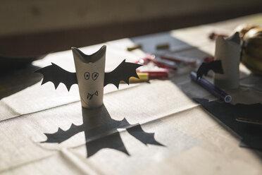 Tinkered paper bats on desk - ASCF000496