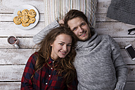 Portrait of happy young couple lying together on the floor - HAPF000187