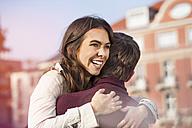 Germany, Berlin, happy young couple hugging - GCF000145