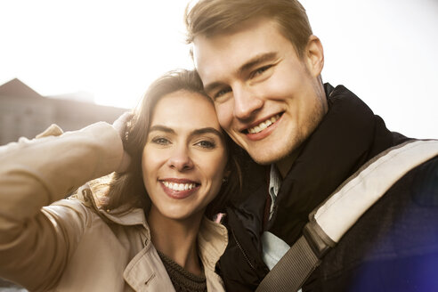 Portrait of smiling young couple outdoors - GCF000172