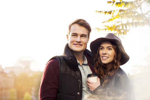 Smiling young couple with coffee to go - GCF000175