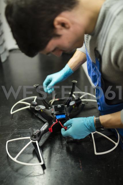 Mechanic repairing a drone in his workshop - RAEF000829