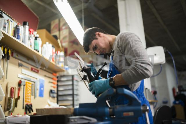 Mechanic repairing a drone in his workshop - RAEF000832