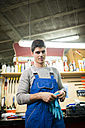Portrait of a mechanic in his workshop - RAEF000835