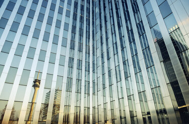 Germany, Duesseldorf, office building, Rhine tower mirrored in glass facade - GUFF000259