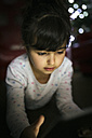 Portrait of little girl using digital tablet at home - MGOF001329