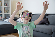 Fumbling boy with Virtual Reality Glasses - SARF002530
