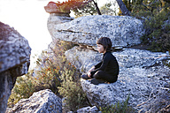 Spain, Siurana, little boy relaxing on a rock - VABF000130