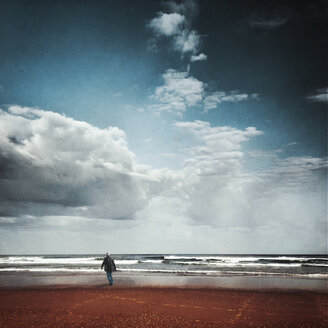 France, Contis-Plage, man walking on the beach looking to the sea, textured effect - DWIF000678
