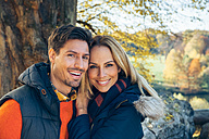 Portrait of happy couple in autumn forest - CHAF001577