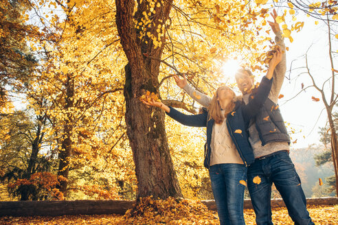 Happy couple having fun in autumn in a forest - CHAF001586