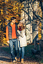 Happy couple strolling in autumn in a forest - CHAF001595