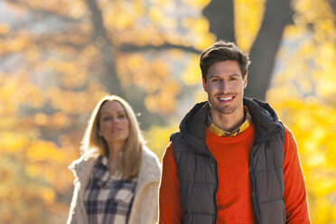Happy couple enjoying autumn in a park - CHAF001601