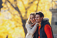 Happy couple enjoying autumn in a forest - CHAF001637