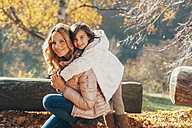 Portrait of mother and her little daughter in autumn - CHAF001643