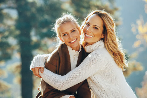 Portrait of happy mother and adult daughter in autumn - CHAF001646