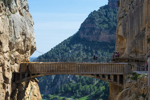 Spain, Ardales, The King's Little Pathway, tourists standing on skywalk looking at view - KIJF000166