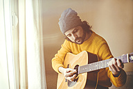 Man playing a acoustic guitar - KIJF000168