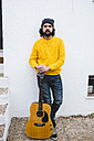 Spain, Jerez de la Frontera, Man with acoustic guitar - KIJF000171