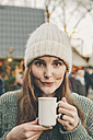 Woman having a hot punch on the Christmas Market - MFF002654