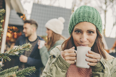 Woman having a hot punch on the Christmas Market - MFF002675