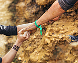 Participants in extreme obstacle race helping each other - MGOF001378