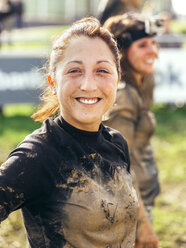 Participant in extreme obstacle race, portrait - MGOF001399